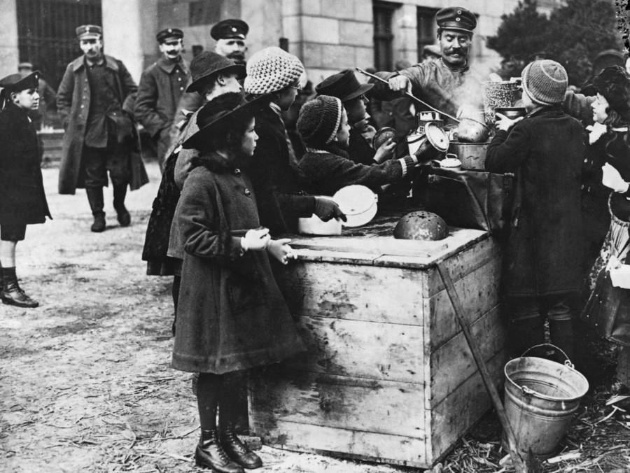Children At An Outdoor Soup Kitchen