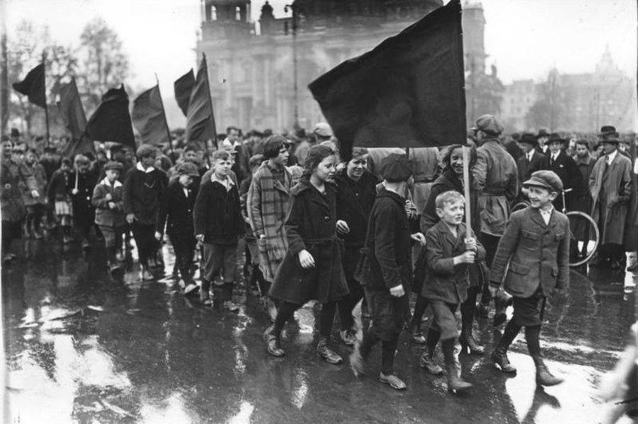 Children Marching On Street