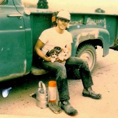 Coal Miner With Puppies
