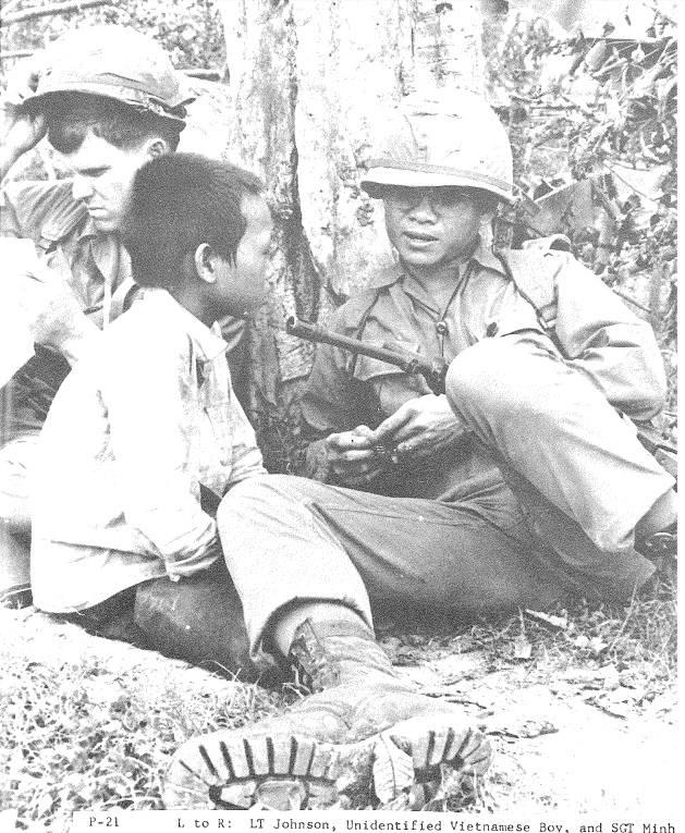 Lt Johnson With Gun And Child