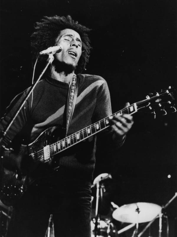 Marley Playing Guitar On Stage