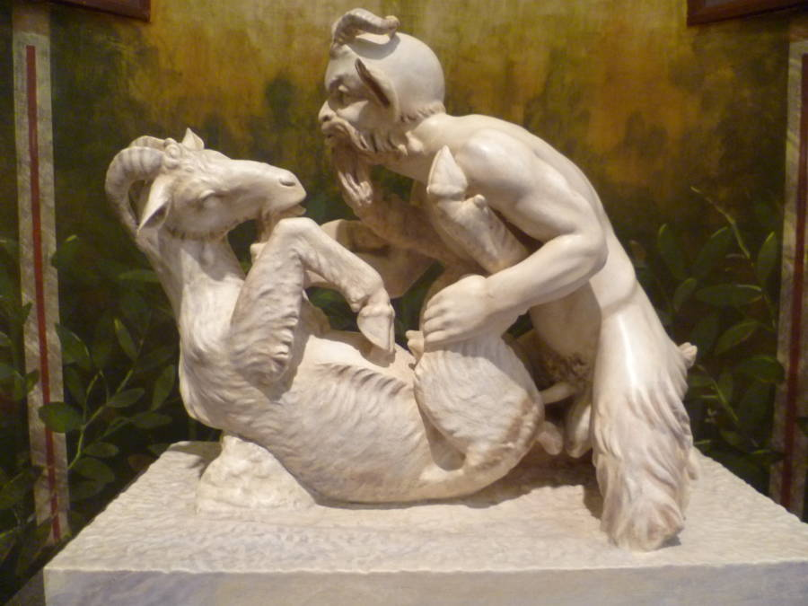 Man having sex with a goat statue
