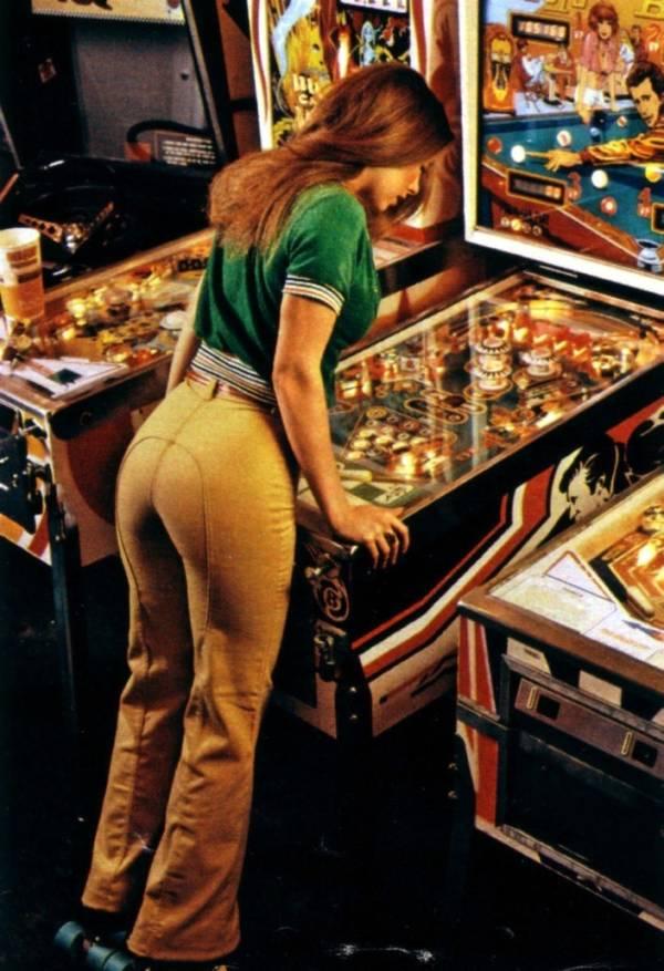 Person Playing Pinball