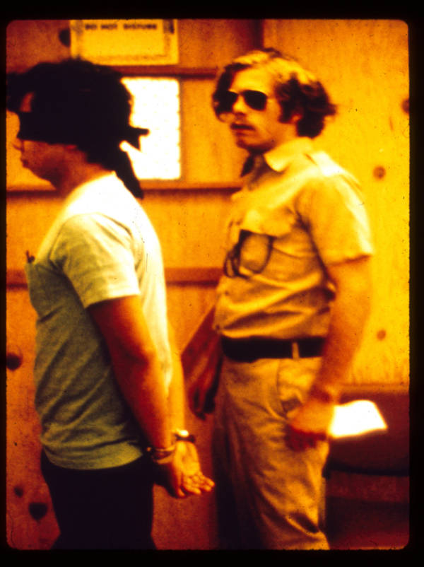 Stanford Prison Experiment guard escorts prisoner