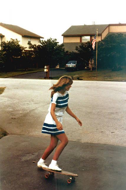 Woman Skateboarding In Dress