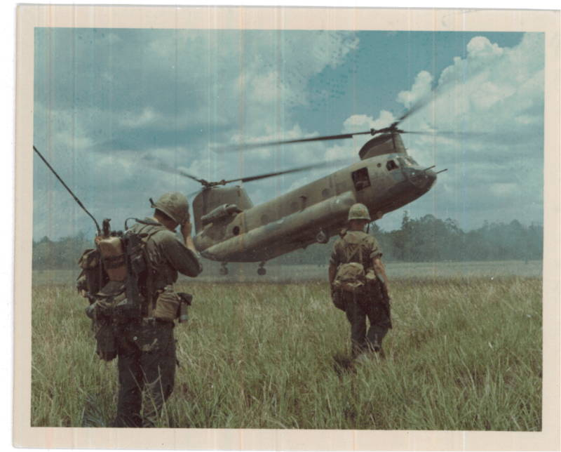 Soldiers Approaching Helicopter Grass