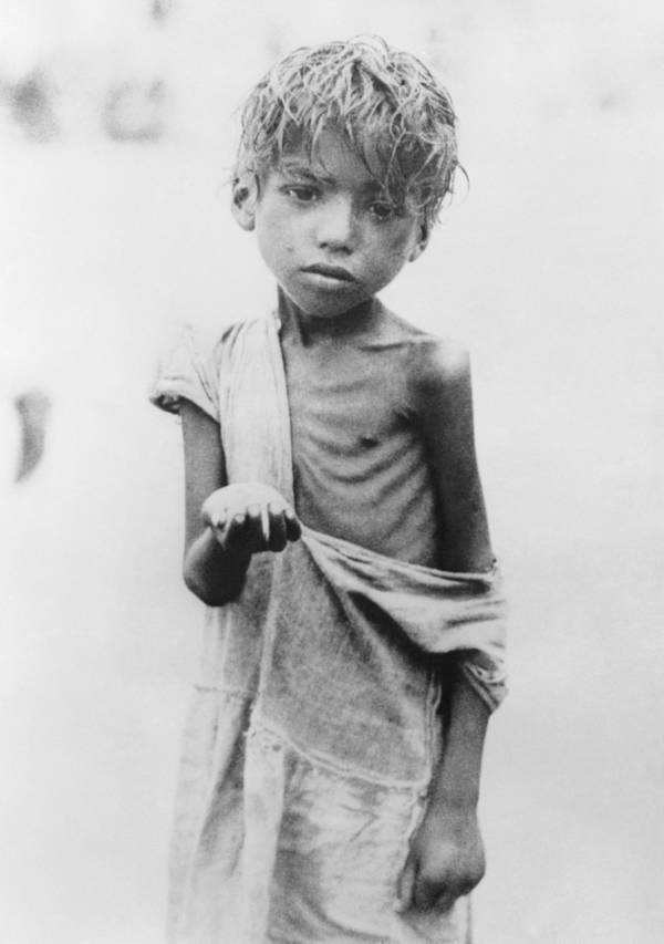 Starving Bengali child with an outstretched hand