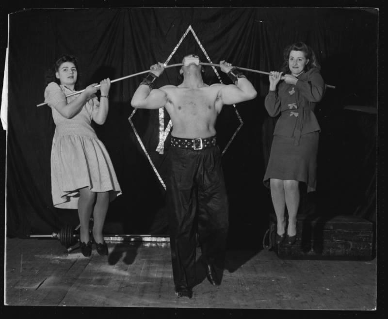 Strongman Lifts Two Women
