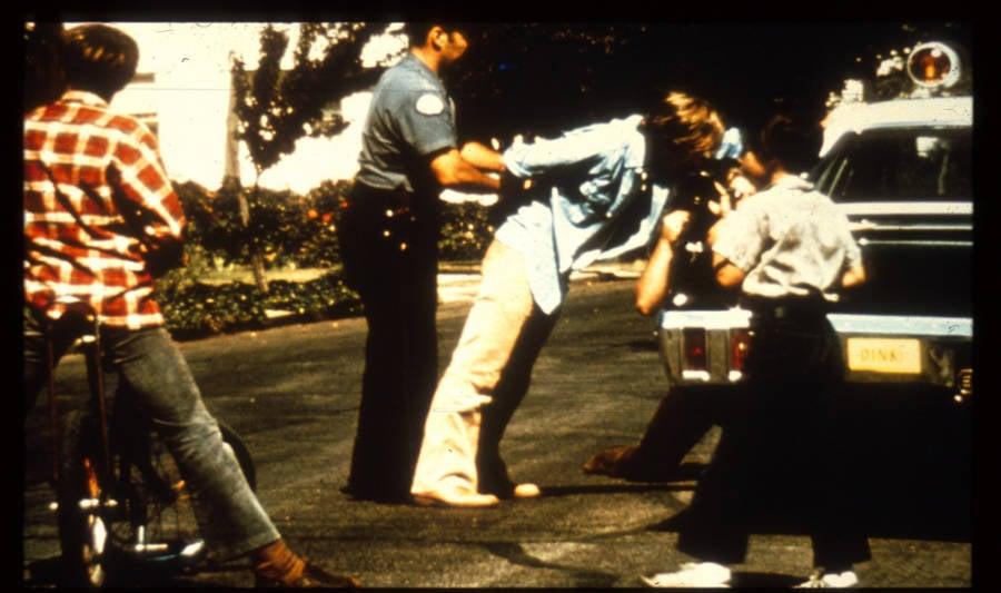 Stanford Police handcuff prisoner