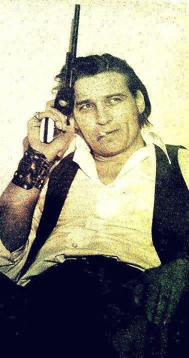 Waylon Jennings with a gun