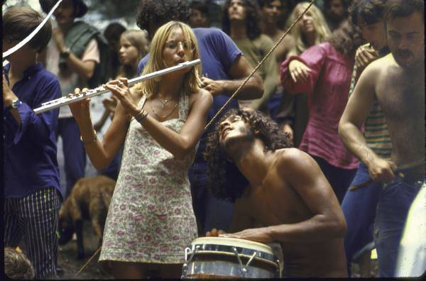 Young Hippies Playing Instruments