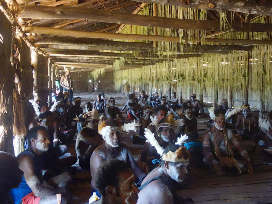 Asmat tribesmen gathered in a longhouse