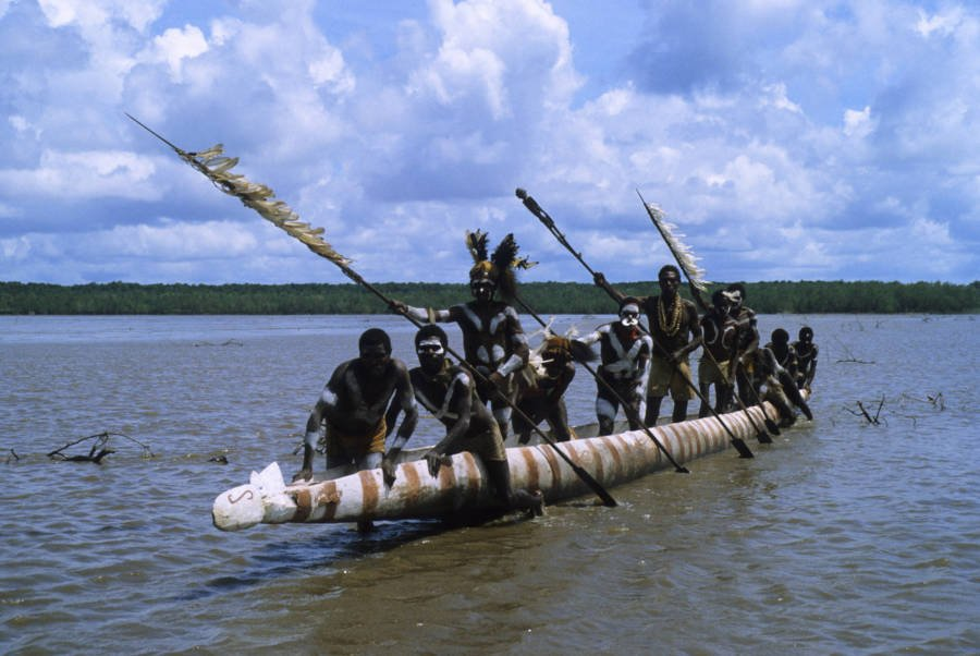 Asmat Tribesmen On A Canoe
