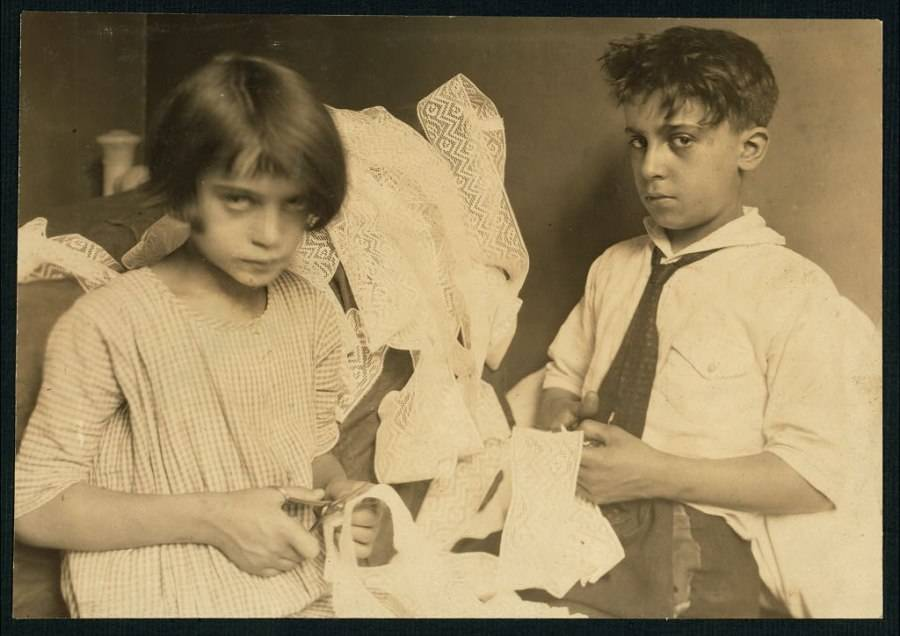 Boy And Girl Working With Lace