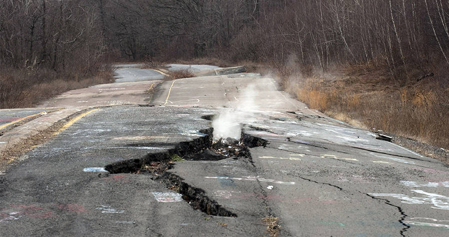 Cracked Centralia road with smoke coming out of it