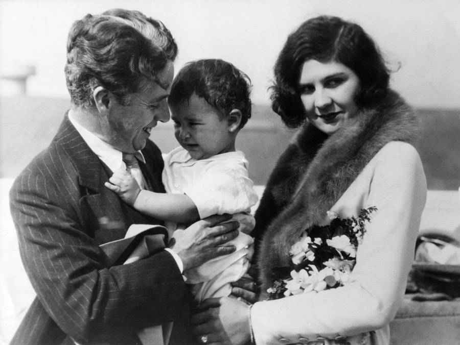 Charlie Chaplin with Lita Greay and their baby