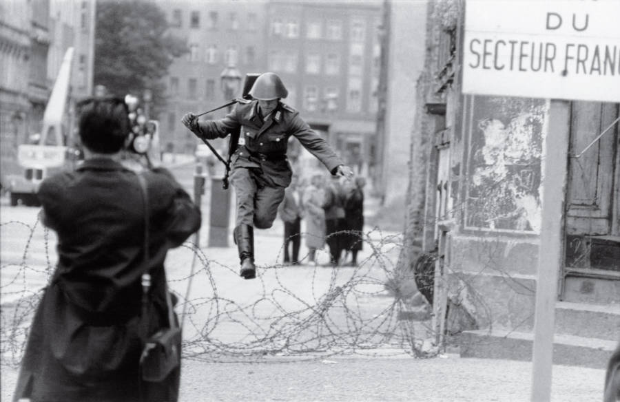 Soldier Leaping Over Berlin Wall