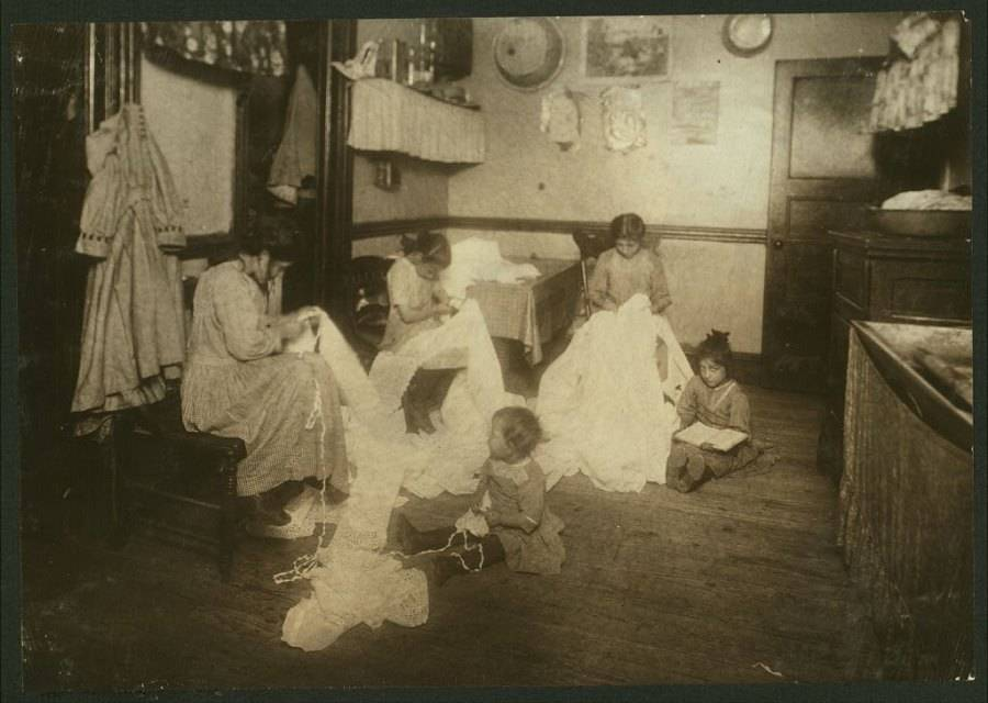 Family Sewing Kids On Floor