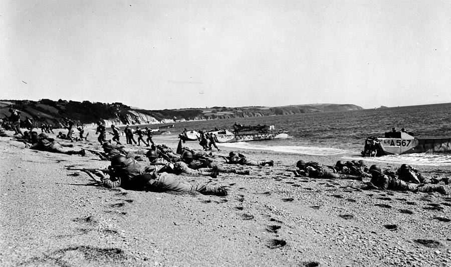 U.S. Troops crawl on beach shores