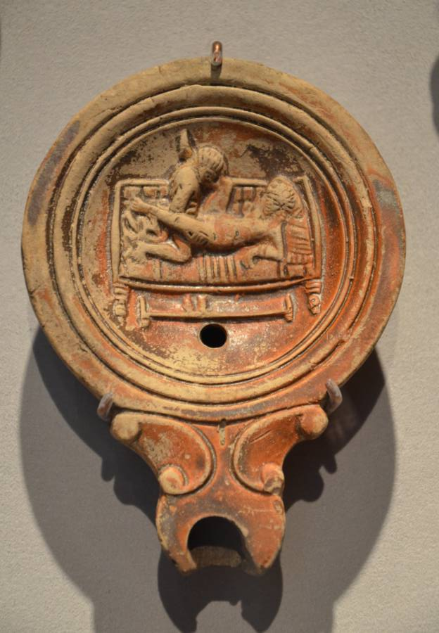 Roman oil lamp with erotic art