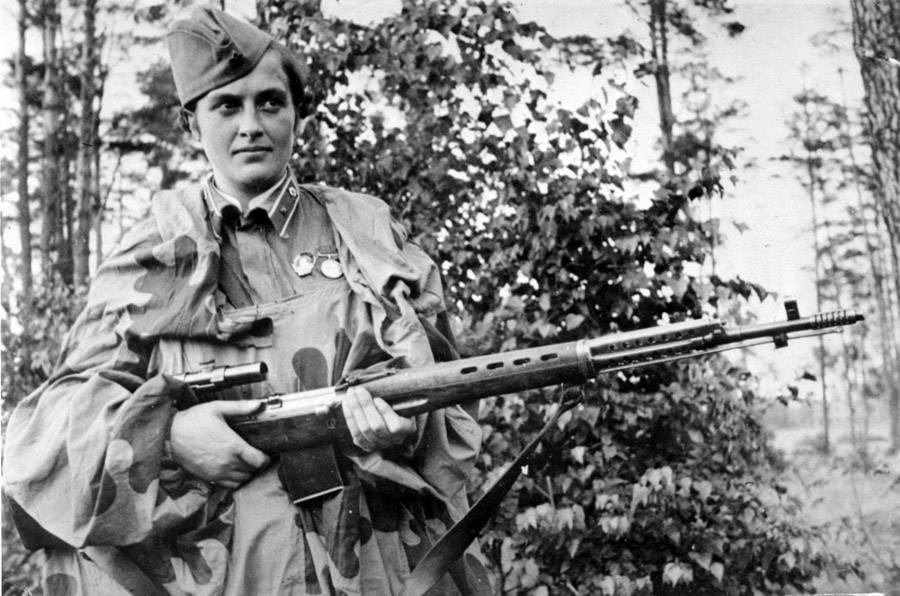 Soviet soldier Lyudmila Pavlichenko poses with her gun