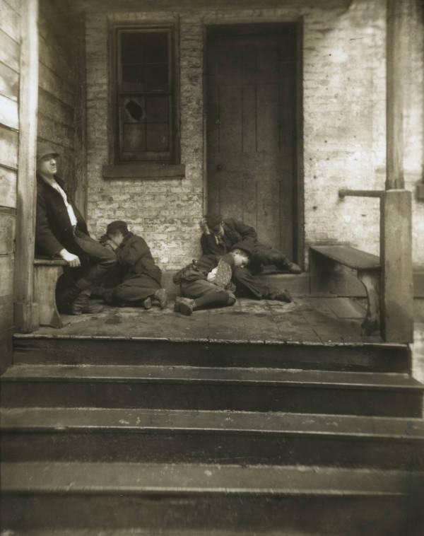 Men Sleeping On The Stoop