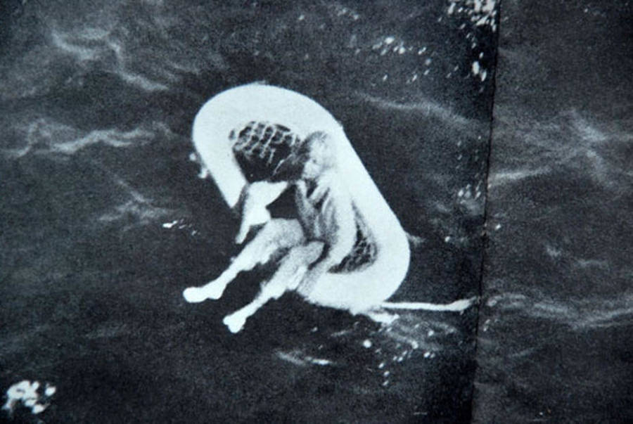 Young Terry Jo Duperrault sitting on a raft in the ocean