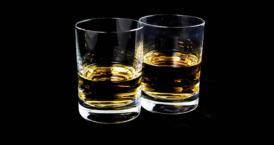 Whiskey glasses black background