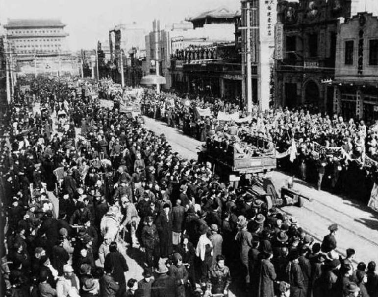 Communist Forces March Into Peking