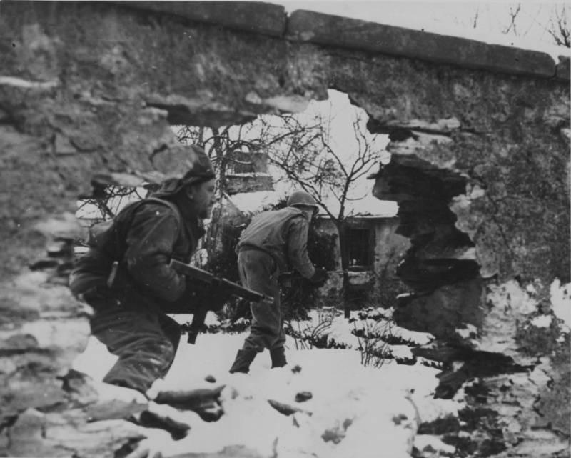 U.S. soldiers walk through Belgium