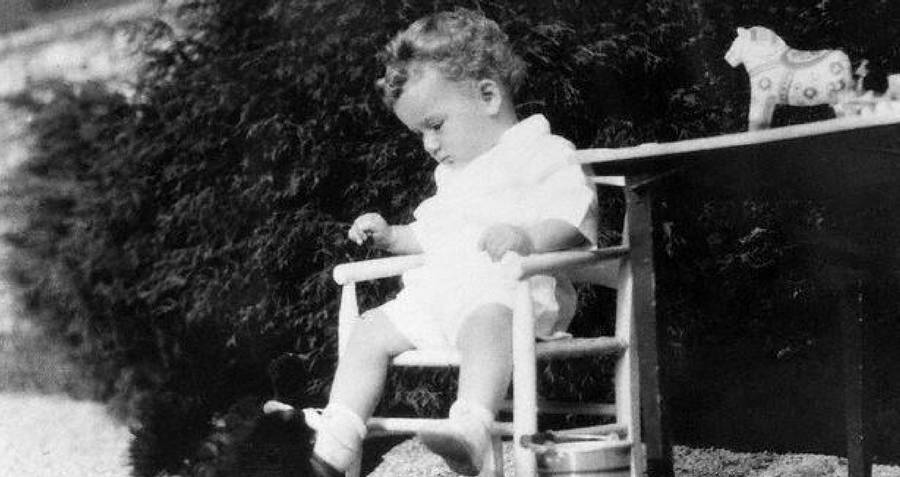 Lindbergh baby sitting in a chair
