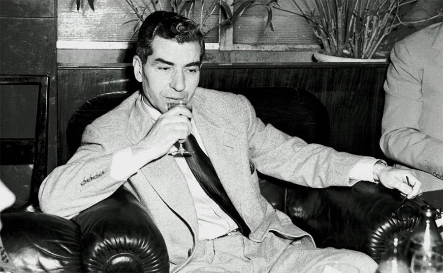 Lucky Luciano drinking wine.
