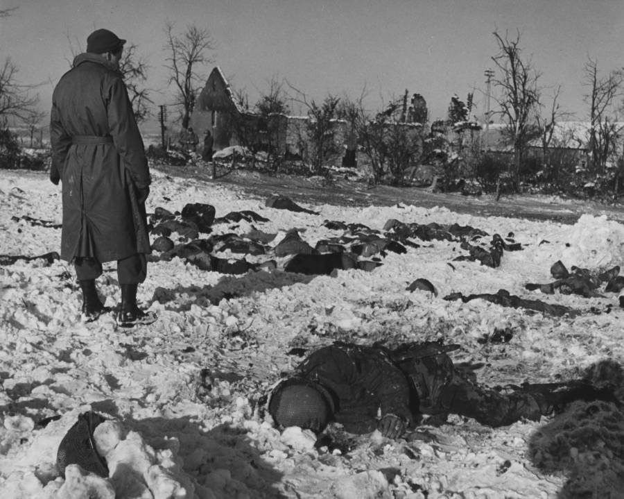 Dead bodies in a snowfield during the Malmedy massacre