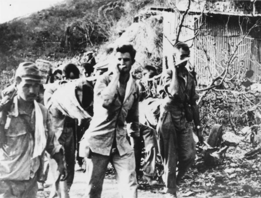 Servicemen Carry Dead