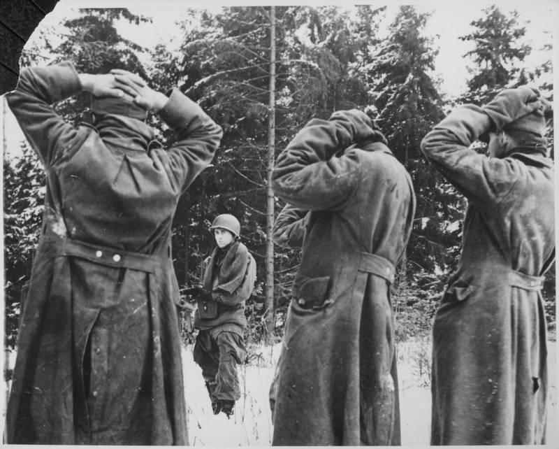 U.S. troops taking prisoners