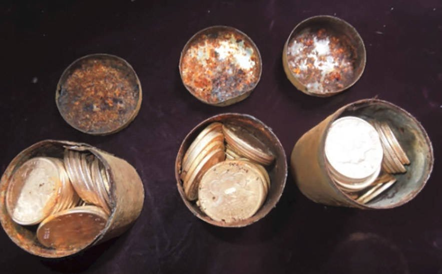 Cans of gold coins from the Saddle Ridge Hoard.