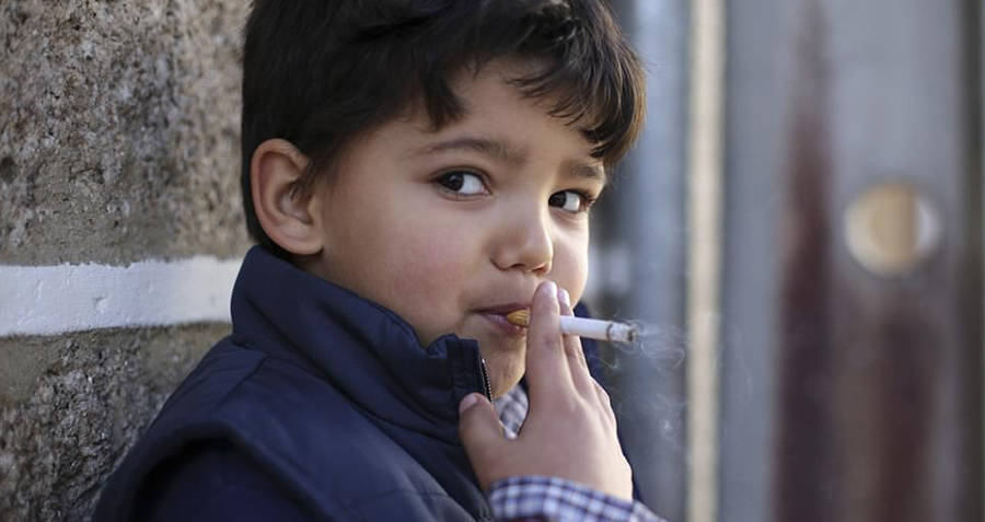 Child Young boy smoking in Portugal