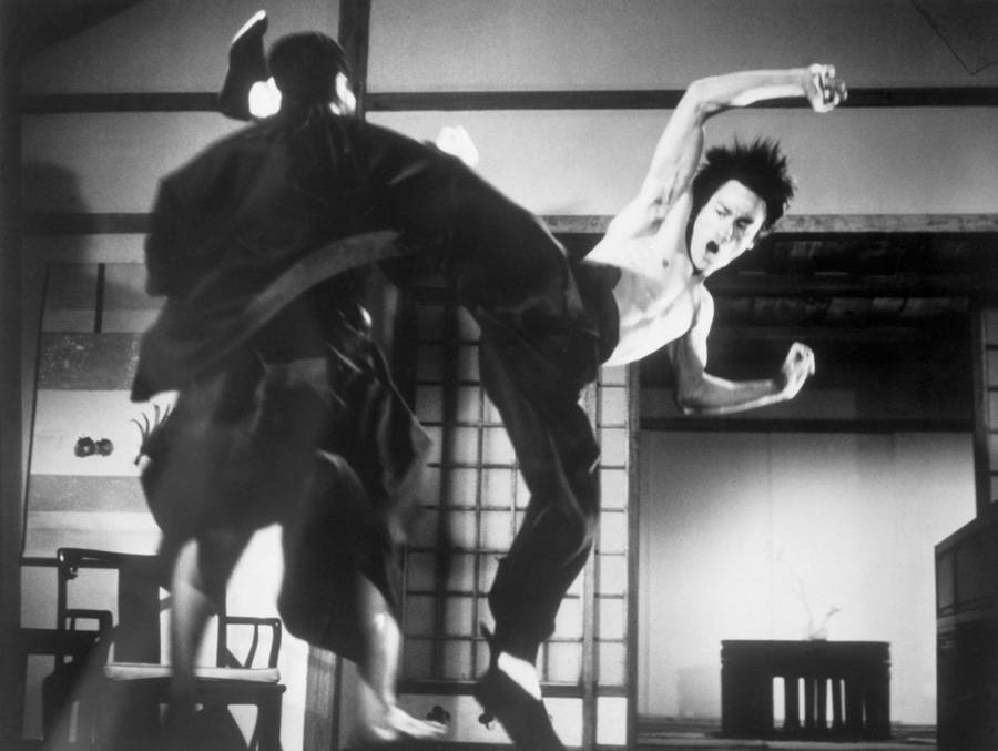 Bruce Lee in a fight scene from The Chinese Connection