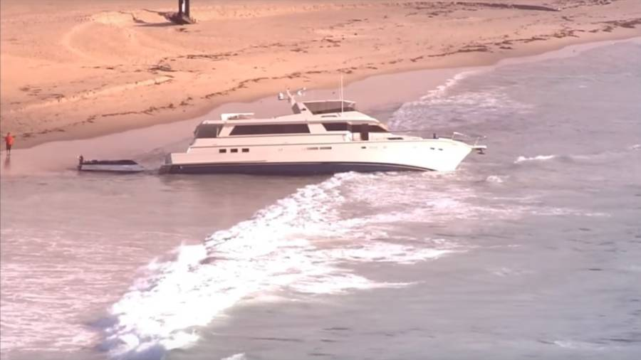 Yacht Washed Up On Beach
