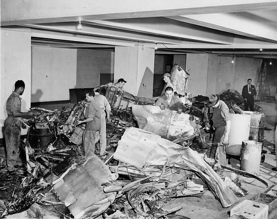 A crew cleans up debris from the Empire State Building plane crash