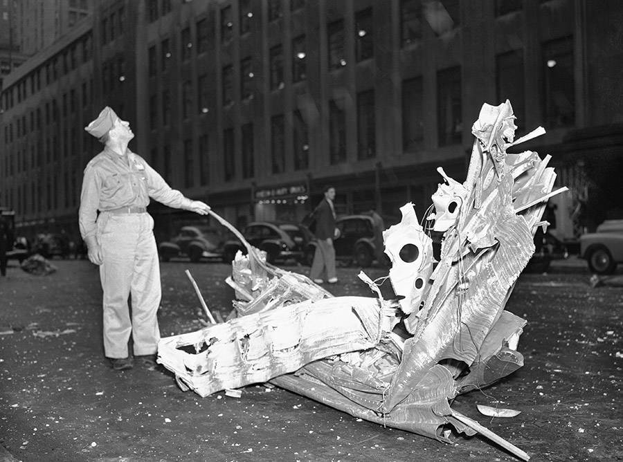 A man stands over debris from the Empire State Building plane crash