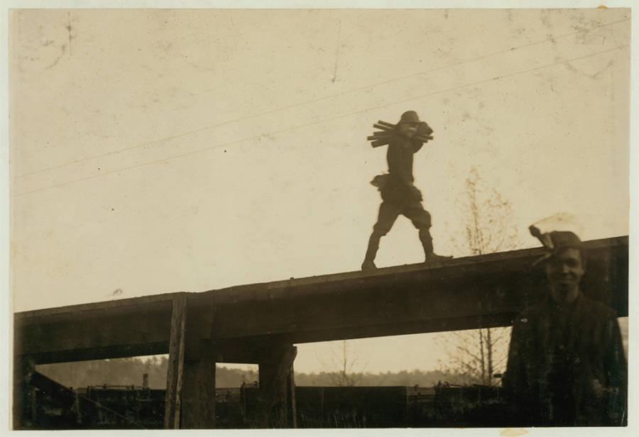 Boy Carries Steel Rods
