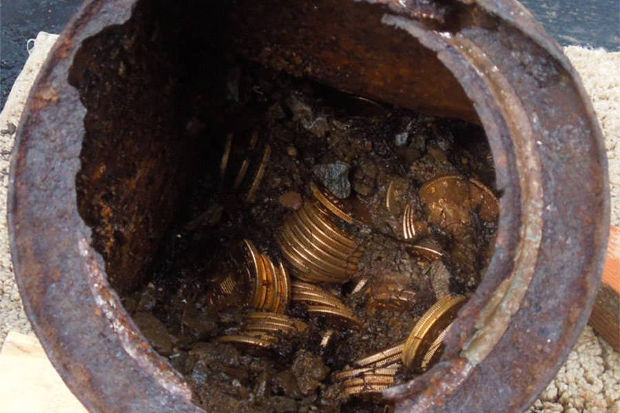 Saddle Ridge gold coins in a tin can