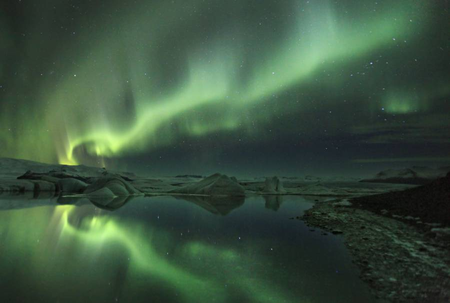 Northern Lights Of Iceland Over Water