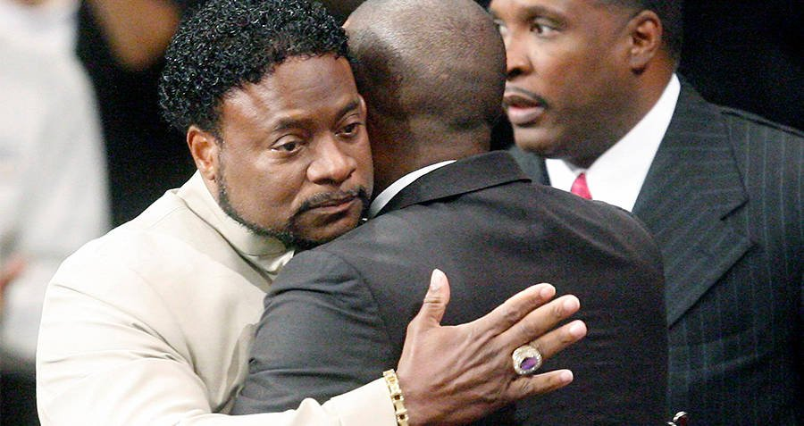 Eddie Long Hugging Man