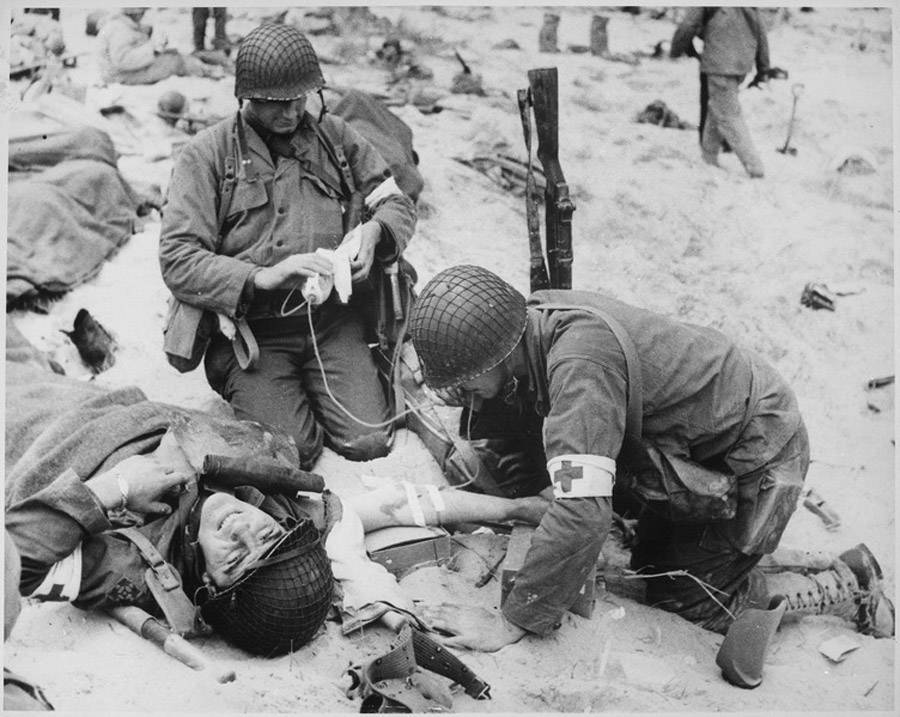 Combat Medics Giving First Aid