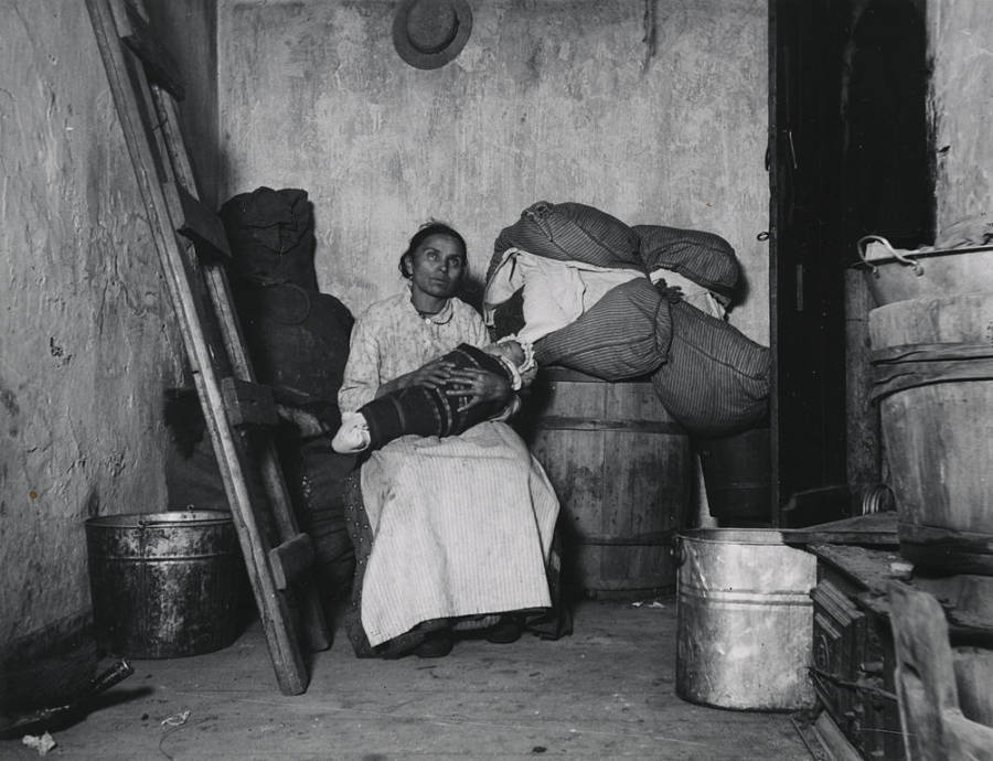Immigrant Woman Holding Baby