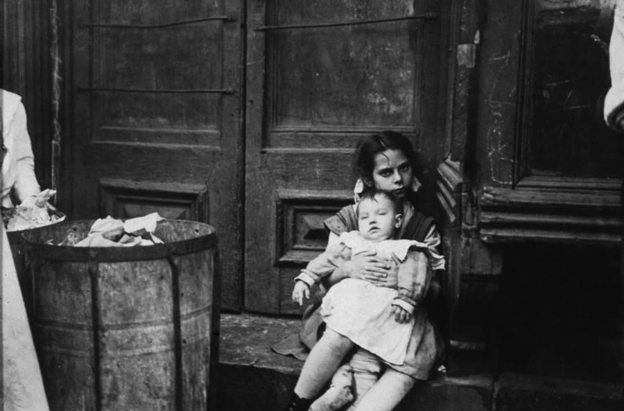 Jacob Riis Photographs Girl Holding Baby