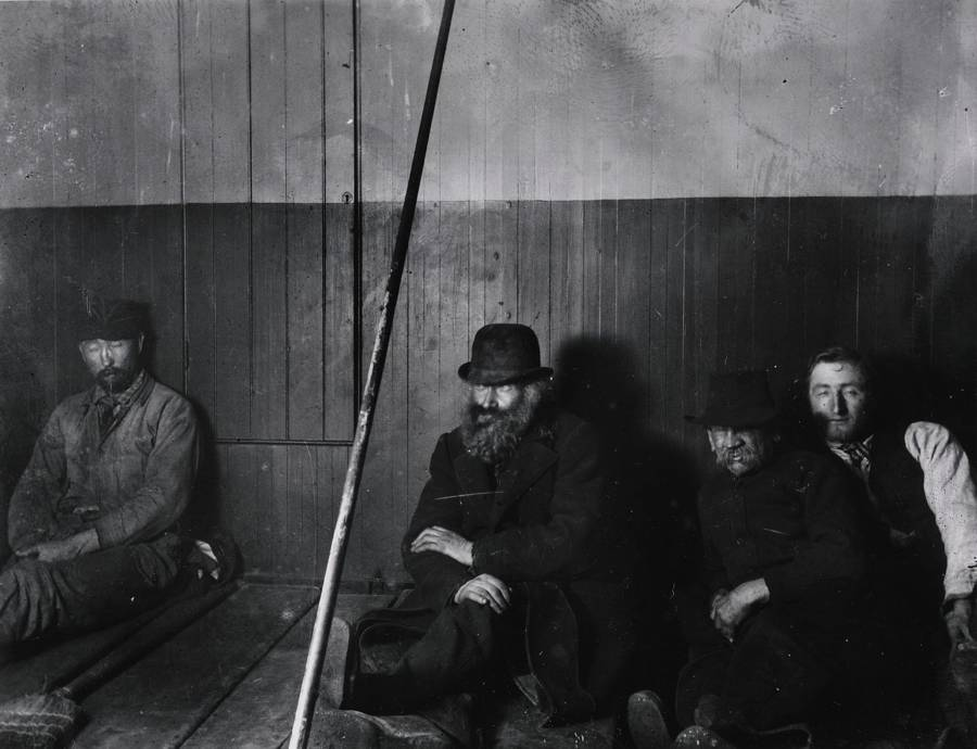 Men Leaning Against Wall
