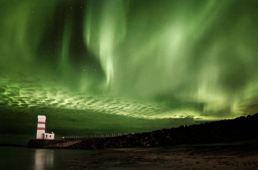 Northern Lights In Iceland Over Lighthouse